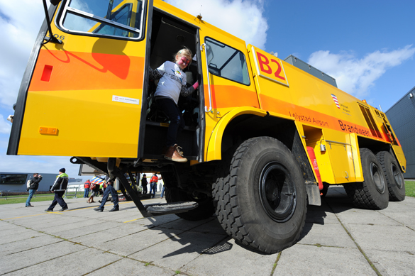 Exploring one of the fire trucks that escorted the children to Lelystad Airport